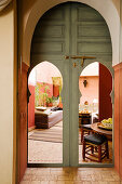 View through open doors with pointed arches into Moroccan living room