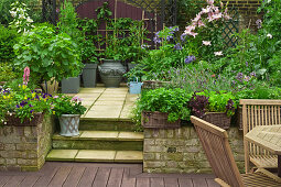 Terrace with different flooring materials separated by steps