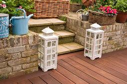 Garden lanterns on terrace with wooden decking