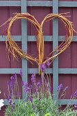 Wicker heart on trellis in garden