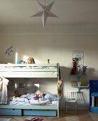 Children in bunk beds in rustic children's bedroom