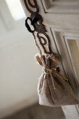 Lavender bag hanging from key in door lock