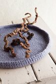 Crocheted and felted woollen dish