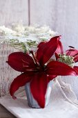 Arrangement of red lilies and wild carrot