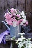 Bouquet of roses, thistles and wild carrot
