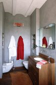 Small, cosy bathroom with many wooden elements and walls painted with marbled effect