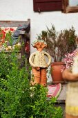 Ceramic figurine on veranda of farmhouse