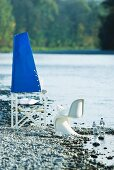 Original chair decoration (blue sail on chair back) for summer party on river bank