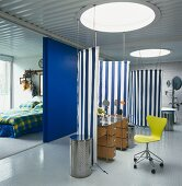 Open-plan living with areas partitioned off by awning fabric