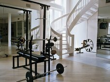 Home gym with free-standing staircase