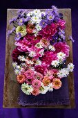 Arrangement of various late summer garden flowers in shades of pink, violet and white