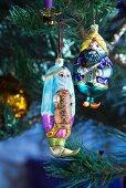 Christmas tree baubles shaped like Oriental figures
