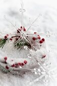 Ice dish with holly berries and glass star ornament