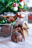 Ornate Christmas bauble and basket of Christmas decorations on rug
