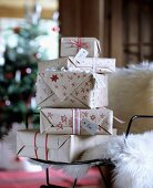 Christmas presents wrapped in hand-decorated paper