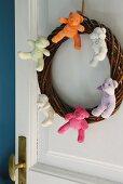 Door wreath decorated with teddy bears