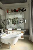 Bathroom with free-standing bathtub and twin sinks on partition