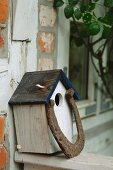 Birdhouse at timber-framed house