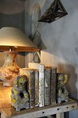 Books, bookends and lamp on wooden table