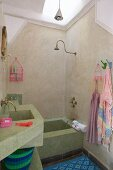 Mediterranean atmosphere in bathroom with masonry bathtub and washstand