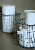 Toilet paper in vintage wire basket