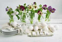 Easter table centrepiece of violas & blown eggs