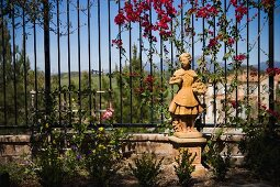 Stone girl statue in landscaping