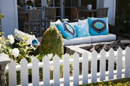 Patio furniture with brightly colored throw pillows