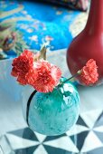 Pinks in turquoise glass vase