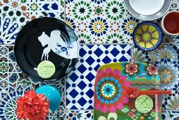 Plates and dishes on colourful tiles