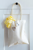 Bag with cord handles and decorative hearts