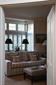 View through doorway of sofa in rustic living room