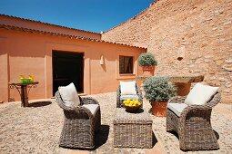 Wicker furniture on stone patio