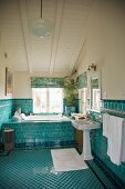 Attic bathroom with turquoise tiles