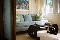 Blue sofa and wooden coffee table