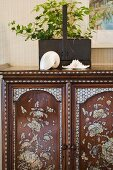 Wood dresser with abalone accents