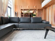 Modern living room with black leather sofa