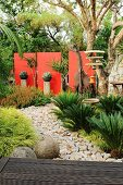 Exotic garden complex with stony path & various decorative elements