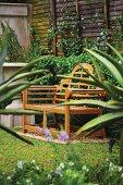 A wooden garden bench in a garden