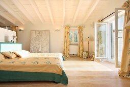 Master bedroom with French doors open to outdoor balcony