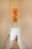 Artwork above staircase