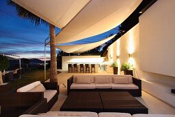 Contemporary outdoor sitting area at dusk
