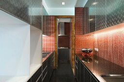 Modern kitchen with cabinets and mosaic tile wall