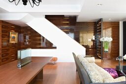 Staircase table and sofa in modern interior