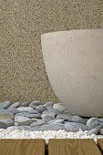 Concrete pot on stones detail