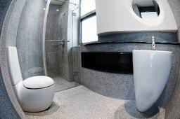 View through a fish eye lens of a futuristic, concrete bathroom with white designer bathroom fixtures