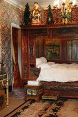 Indian-inspired bedroom with alcove bed