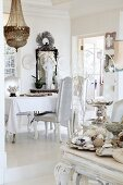 Eclectic collection of objet in white dining room