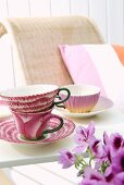 Elegant teacups on sunny table