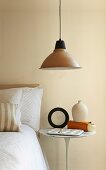 Retro pendant lamp with metal lampshade above bedside table